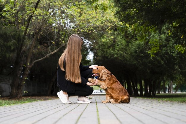 woman-with-her-dog-in-park